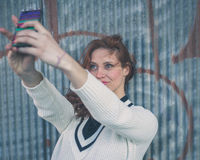 Beautiful girl taking a selfie in an urban context Royalty Free Stock Photography