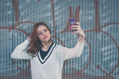 Beautiful girl taking a selfie in an urban context Royalty Free Stock Photo