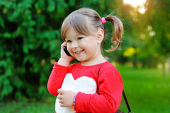 Beautiful girl talking on cell phone Royalty Free Stock Photos