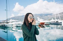 Beautiful girl talking on a cell phone royalty free stock photography