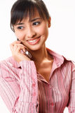 Beautiful girl talking on her mobile phone Royalty Free Stock Photos