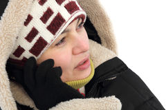 Beautiful girl talking by mobile phone. In winter stock image
