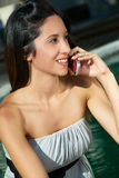 Beautiful girl talking on a mobile phone Stock Images