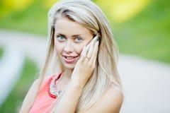 Beautiful girl talking mobile phone Stock Image