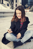 Beautiful girl talking on mobile phone in urban city Stock Images