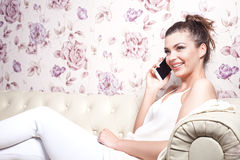 Beautiful girl talking by mobile phone. Royalty Free Stock Photos