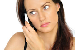 Beautiful girl talking by phone Royalty Free Stock Images