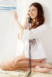 Beautiful girl talking on the phone Stock Images