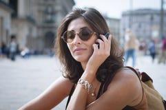 Beautiful girl talking on the phone Stock Image