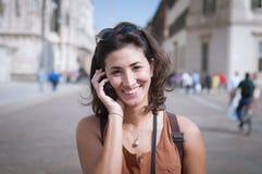 Beautiful girl talking on the phone Stock Photo