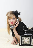 Beautiful girl talking on the phone. Beautiful girl with an old phone on a white background stock photos