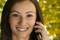 Beautiful Girl Talking on the Phone Royalty Free Stock Image
