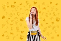 Beautiful girl talking on the phone while being in a cafe royalty free stock photos