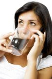Beautiful girl talking on the phone while drinking coffee Stock Photo