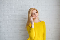 Beautiful girl talking on the phone Royalty Free Stock Photos
