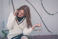 Beautiful girl talking on phone in an urban context Stock Images