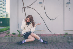 Beautiful girl talking on phone in an urban context Royalty Free Stock Images