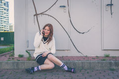 Beautiful girl talking on phone in an urban context Royalty Free Stock Photo
