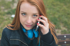 Beautiful girl talking on phone in an urban context Royalty Free Stock Photography