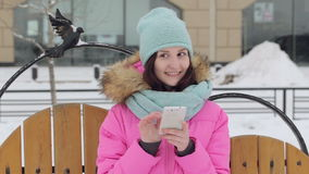 Beautiful girl talking on the phone, winter stock video footage