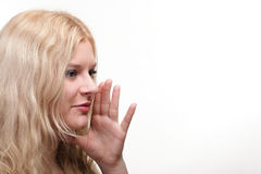 Beautiful girl talking speaking out hands mouth white background Royalty Free Stock Image