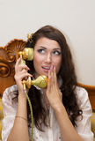 Beautiful girl talking on telephone Royalty Free Stock Image
