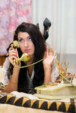 Beautiful girl talking on telephone Royalty Free Stock Photography