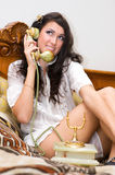 Beautiful girl talking on telephone Royalty Free Stock Photos