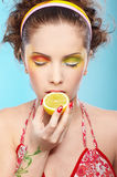 Beautiful girl tasting lemon Royalty Free Stock Image