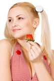 Beautiful girl tasting a strawberry Stock Image