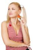 Beautiful girl tasting a strawberry Stock Photos