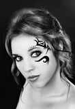 Beautiful girl with a tattoo on his face Stock Photography