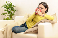 Beautiful girl tea coffee hot beverages relaxing ill Stock Photos
