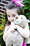 Beautiful Girl with Teddy Bear. Beautiful young girl posing with her best friend, her Teddy Bear, in an outdoor setting Royalty Free Stock Photography
