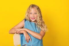 Beautiful girl teenage with perfect teeth and smile looking to camera. Posing on studio stock photo