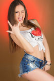 Beautiful girl teenager in denim shorts and shirt Royalty Free Stock Images