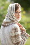 Beautiful girl, a teenager in a poncho with the national pattern Stock Images