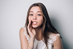 Beautiful girl telling a secret. Royalty Free Stock Images