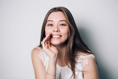 Beautiful girl telling a secret .Portrait young happy woman. Stock Photos