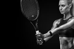 Beautiful blonde sport woman tennis player with racket in red costume stock image