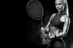 Beautiful blonde sport woman tennis player with racket in red costume royalty free stock photography