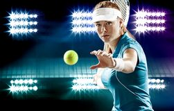 Beautiful girl tennis player with a racket on dark. Beautiful sport woman tennis player with a racket in blue costume Stock Photos