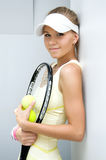Beautiful girl with a tennis racket. Portrait of a beautiful girl with a tennis racket Royalty Free Stock Images