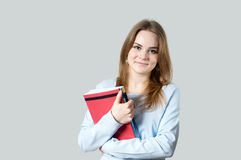 Beautiful girl with textbooks Stock Photo