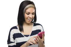 Beautiful Girl Texting. Happy young girl sending a text message on her cellphone royalty free stock photo