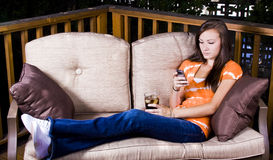 Beautiful Girl  Texting in the Patio Stock Image