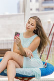 Beautiful girl texting and taking self picture on the park Stock Photo