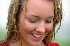 Beautiful girl in th eRain. Girl soaked from the rain and laughing Royalty Free Stock Image