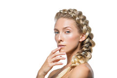 Beautiful girl with thick french braid. Beautiful blond young woman with thick french braid and natural make-up. on white background. Copy space stock photo
