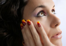 Beautiful girl thinking. Beautiful young girl with colorful nails and make up, thinking Stock Photos